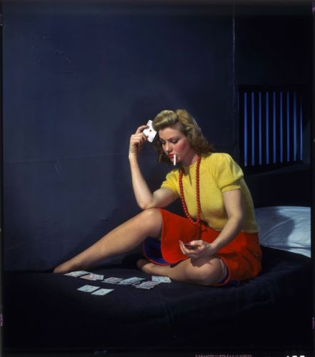 Nickolas Muray (1892-1965) - Woman in cell, playing solitaire 1950