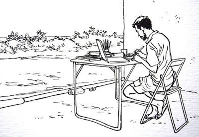 Un dessinateur à table